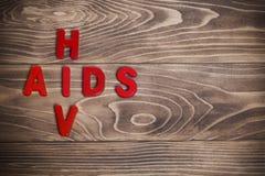 HIV de rode brieven van AIDS stock foto