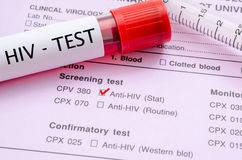 HIV infection screening test form. Sample blood collection tube with HIV test label on HIV infection screening test form royalty free stock images