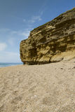 Hive Beach Cliffs. Sandstone Cliffs with pebbled beach. Hive Beach, Burton Bradstock, Bridport, Dorset, England, United Kingdom Royalty Free Stock Photo