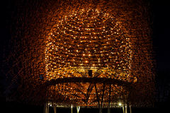 Hive of light and steel illuminated at night. Lights and steel are constructed in a form of hive and illuminated at night symbolising natural hive Stock Images