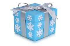 Hiver de cadeaux de flocons de neige d'arc de boîte-cadeau de Noël d'isolement sur le petit morceau Photographie stock libre de droits