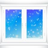 Hiver derrière une fenêtre Image libre de droits