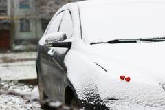 Hiver rouge deux de coeurs de neige Images stock