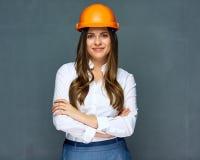 Hjälm för byggmästare för kvinnatekniker bärande arkivfoton