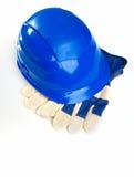 Hjälm och skyddande handskar Arkivbilder