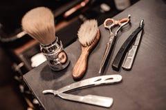 Hjälpmedel av barberaren shoppar arkivfoton
