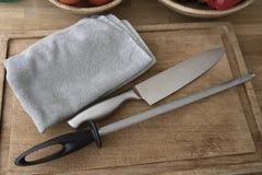 Hjälpmedel för att honing kniven royaltyfria foton