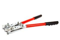 Hjälpmedel för att krusa elektriska kablar på vit bakgrund Royaltyfri Fotografi