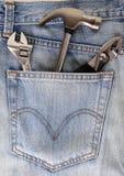hjälpmedel för blå jean Arkivfoto