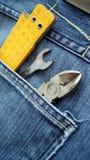 Hjälpmedel och jeansfack Arkivfoto