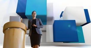 hjälteskott av den kvinnliga presentatören mot den abstrakta platsen 3d med kuber royaltyfri foto