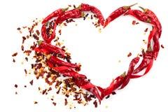 Hjärta av chilipeppar Arkivfoto