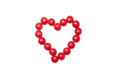 Hjärta av den röda chokladen - bestruken godis Royaltyfri Foto