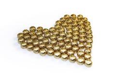 Hjärta av guldpärlor Arkivbild