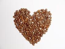 Hjärta av kaffebönor Arkivbilder