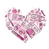 Hjärta av makeupproduktuppsättningen Arkivfoto