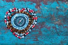 Hjärta av pärlor med kompasset Royaltyfri Bild