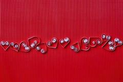 Hjärta av papper som quilling för valentin dag Arkivbilder