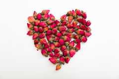 Hjärta av rosa färger slår ut på en vit bakgrund royaltyfria foton