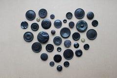 Hjärta av svarta knappar Fotografering för Bildbyråer