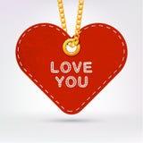 Hjärta Etikettetikett som hänger på guld- kedja Royaltyfria Bilder