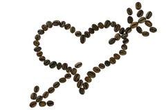 Hjärta för kaffeböna som trängas igenom av en pil arkivfoto