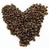 Hjärta för kaffebönaförälskelse Arkivbild