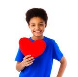 Hjärta för valentin för skolapojke hållande Royaltyfria Bilder