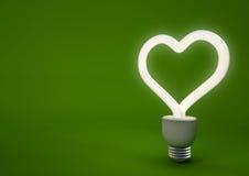 Hjärta formad energi - sparande ljus kula Fotografering för Bildbyråer