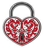 Hjärta formad hänglås i tappning inristad stil Arkivfoto