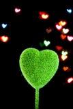 Hjärta-formad objekt- och suddighetsbakgrund Arkivfoto