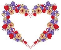 Hjärta-formad ram med dekorativa blommor Arkivfoto