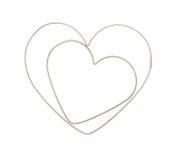Hjärta formade bakelseskärare Arkivbild