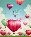 Hjärta-formade ballonger för varm luft som tar av Arkivfoton