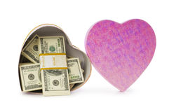 Hjärta formade gåvaask och dollar Royaltyfri Foto