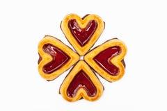Hjärta formade kakor gör en fyra ut sprucken växt av släktet Trifolium Royaltyfria Foton