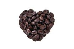 Hjärta formar vid kaffebönor Fotografering för Bildbyråer