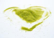 Hjärta format grönt te royaltyfri bild