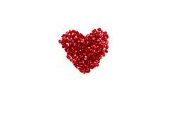 Hjärta-format granatäpplefrö Royaltyfri Foto