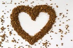 Hjärta från kaffebönor arkivbild