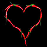 Hjärta. Glödheta chilipeppar Fotografering för Bildbyråer
