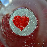Hjärta i ett exponeringsglas Arkivfoto