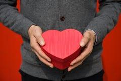 Hjärta i hand Fotografering för Bildbyråer