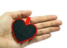 Hjärta i hand Arkivbild