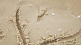 Hjärta i sanden stock video