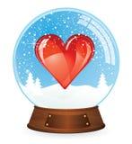Hjärta i Snowjordklot Royaltyfria Foton