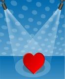 Hjärta i strålkastaren Arkivfoto