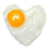 Hjärta isolerat stekt ägg Arkivbild