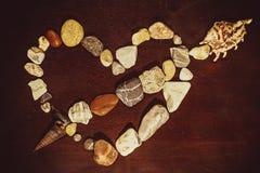 Hjärta lade in stenar Arkivfoton