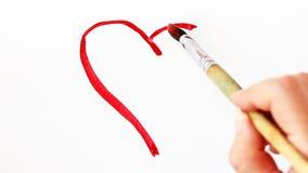 Hjärta målad röd vattenfärg på vit bakgrund lager videofilmer